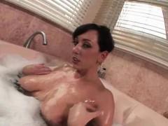 Milf touching her massive boobs