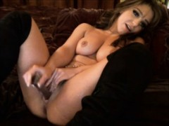 Gorgeous woman open legs and play with toy