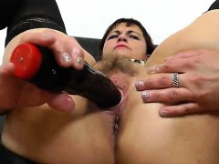 Redhead Remy sucks her fake cock at home