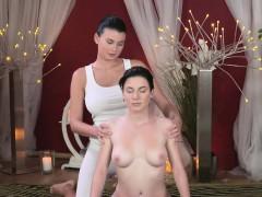 Busty masseuse gives lesbian massage