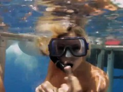 Hot babes in shark cage and snowboarding while all naked