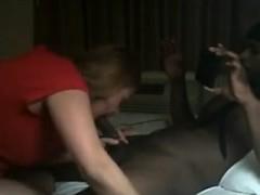 Dark man beating blonde girl at her house