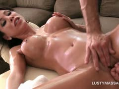 Oily brunette getting her fuck holes fingered by masseur