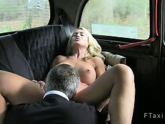 Busty blonde babe ass fingered and cunt fucked in fake taxi