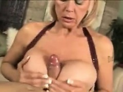 Grandma With Fake Breasts Pleasing A Cock