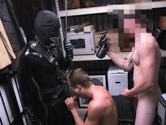 Gay guys turned on by latex Dungeon tormentor with a gimp