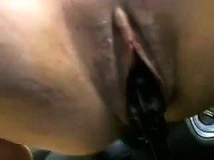 Frothy cunt fingered in his automobile