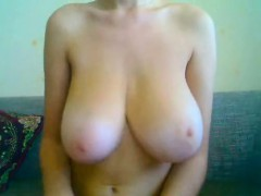 Busty girl with large sagging breasts and her breasts and t