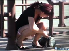 Asian teen pissing park