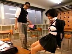 Sweet Asian schoolgirl has her kinky teacher fingering her