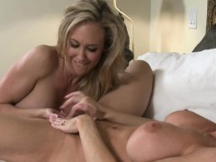 Two big boobs MILFs satisfying pussies in the bedroom