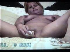 Mature blonde granny loves to masturbate her puss