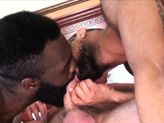 Hunk gets big cock sucked by two black guys